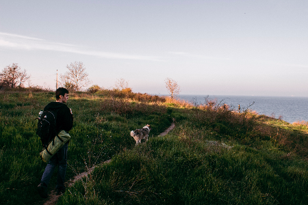 man and his dog out on a hike